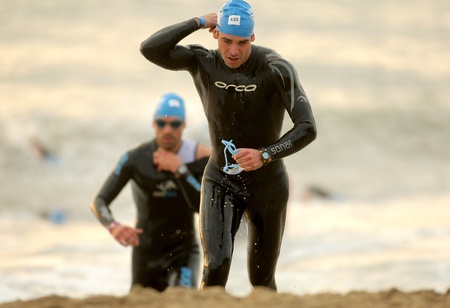 Triathletes on Swimming on the Barcelona Garmin Triathlon event at Barcelona beach on October 16, 2011 in Barcelona, Spain
