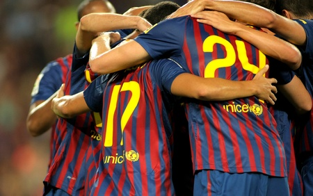 Group of FC Barcelona players celebrating goal during Joan Gamper Trophy match between FC Barcelona and SSC Napoli at Nou Camp Stadium in Barcelona, Spain. August 22, 2011 Stock Photo - 11653172