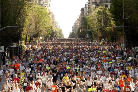 masses: Runners on Cursa de El Corte Ingles, the second most popular race in the world, on Barcelona streets on May 6, 2007 in Barcelona, Spain Editorial