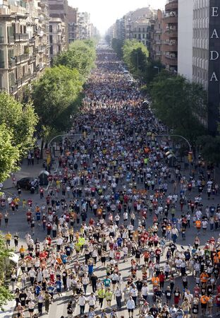 sporting event: Runners on Cursa de El Corte Ingles, the second most popular race in the world, on Barcelona streets on May 18, 2008 in Barcelona, Spain