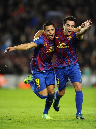 Alexis Sanchez(L) and Xavi Hernandez(R) of FC Barcelona celebrate goal during the spanish league match against Rayo Vallecano at the Nou Camp Stadium on November 29, 2011 in Barcelona, Spain Stock Photo - 11748807