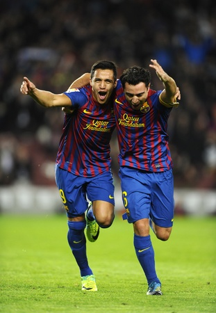 Alexis Sanchez(L) and Xavi Hernandez(R) of FC Barcelona celebrate goal during the spanish league match against Rayo Vallecano at the Nou Camp Stadium on November 29, 2011 in Barcelona, Spain Stock Photo - 11719454