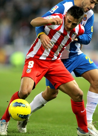 eduardo: Eduardo Salvio of Atletico de Madrid in action during a Spanish League match between Espanyol and Atletico Madrid at the Estadi Cornella on December 11, 2011 in Barcelona, Spain Editorial