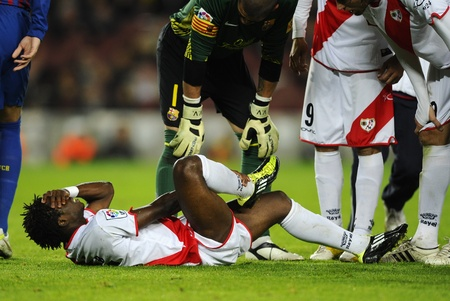 painfully: Lassane Bangoura of Rayo Vallecano injured  during the spanish league match against FC Barcelona at the Nou Camp Stadium on November 29, 2011 in Barcelona, Spain