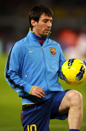 Leo Messi of FC Barcelona playing with the ball  before the spanish league match against Rayo Vallecano at the Nou Camp Stadium on November 29, 2011 in Barcelona, Spain