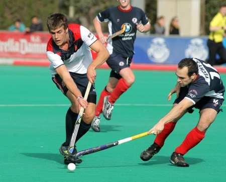 leuven: Alex Casasayas(L) of RC Polo vies with Sebastien Techy(R) of KHC Leuven during a King