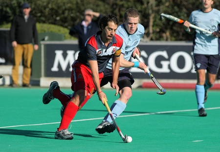 olympics: Alex Fabregas(L) of RC Polo during vies with David Cole(R) of Monkstown HC  a King