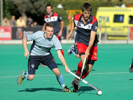 David Watkins(L) of Monkstown HC vies with  Alex Casasayas(R) of RC Polo during a King