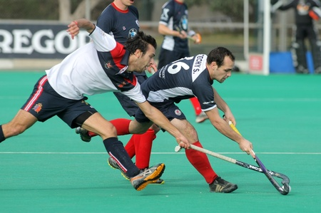 Gabriel Dabanch(L) of RC Polo vies with Sebastien Techy(R) of KHC Leuven during a King Stock Photo - 12159832