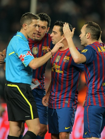 wondered: FC Barcelona players discussed with the referee Iglesias Villanueva during the Spanish league match against Real Betis at the Camp Nou stadium on January 15, 2012 in Barcelona, Spain