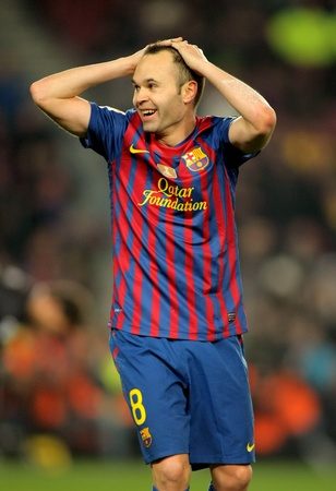 wondered: Andres Iniesta of FC Barcelona during the Spanish league match between FC Barcelona and Real Betis at the Camp Nou stadium on January 15, 2012 in Barcelona, Spain Editorial