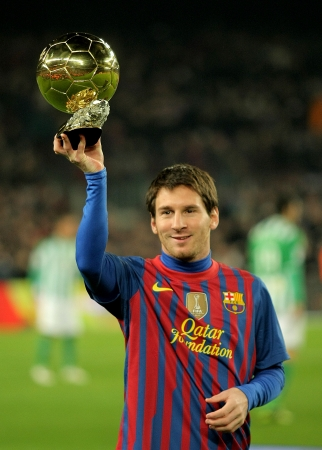 Leo Messi holds up his Golden ball, before the Spanish league match between Barcelona and R Betis at the Camp Nou stadium on January 15, 2012 in Barcelona, Spain