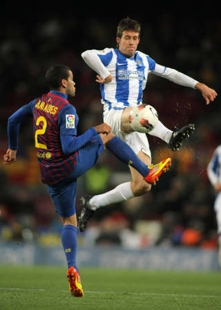 dani: Mikel Aramburu(R) of Real Sociedad vies with Dani Alves(L) of FC Barcelona during the Spanish league match at the Camp Nou stadium on February 4, 2012 in Barcelona, Spain Editorial