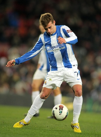 winger: Antoine Griezmann of Real Sociedad in action during the Spanish league match against FC Barcelona at the Camp Nou stadium on February 4, 2012 in Barcelona, Spain Editorial