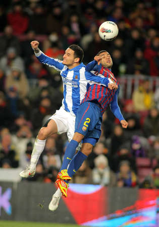 dani: Liassine Cadamuro(L) of Real Sociedad vies with Dani Alves(R) of FC Barcelona during the Spanish league match at the Camp Nou stadium on February 4, 2012 in Barcelona, Spain Editorial