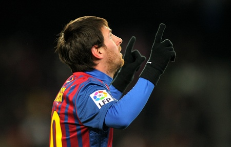Leo Messi of FC Barcelona celebrates goal during spanish league match between FC Barcelona vs Real Sociedad at the Camp Nou stadium on February 4, 2012 in Barcelona, Spain