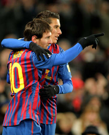 Leo Messi with Cristian Tello of FC Barcelona celebrate goal during spanish league match between FC Barcelona vs Real Sociedad at the Camp Nou stadium on February 4, 2012 in Barcelona, Spain Stock Photo - 12368556