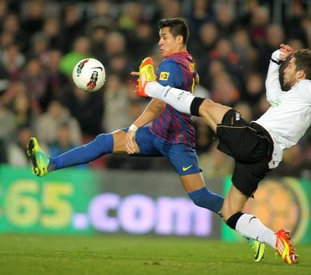 Alexis Sanchez(L) of FC Barcelona vies with Jordi Alba(R) of Valencia CF during the Spanish league match at the Camp Nou stadium on February 19, 2012 in Barcelona, Spain