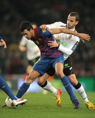 sergio: Sergio Busquets(L) of FC Barcelona vies with Roberto Soldado(R) of Valencia CF during the Spanish league match at the Camp Nou stadium on February 19, 2012 in Barcelona, Spain Editorial