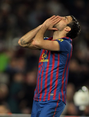 cesc: Cesc Fabregas of FC Barcelona in action during the Spanish league match against Valencia CF  at the Camp Nou stadium on February 19, 2012 in Barcelona, Spain Editorial