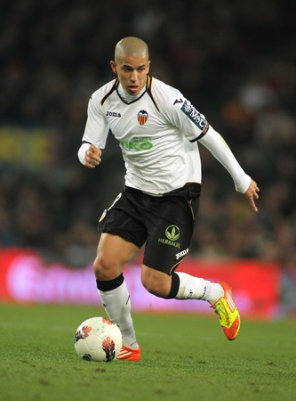 cf: Sofiane Feghouli of Valencia CF in action during the Spanish league match against FC Barcelona at the Camp Nou stadium on February 19, 2012 in Barcelona, Spain