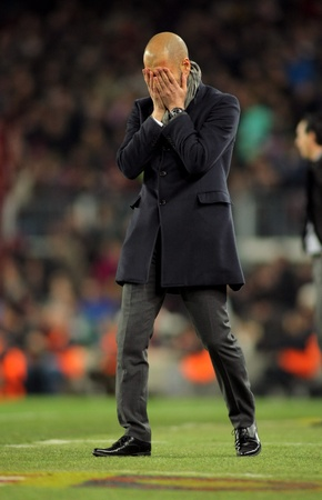 josep: Josep Guardiola of FC Barcelona disappointed  during the Spanish league match against Valencia CFa at the Camp Nou stadium on February 19, 2012 in Barcelona, Spain Editorial