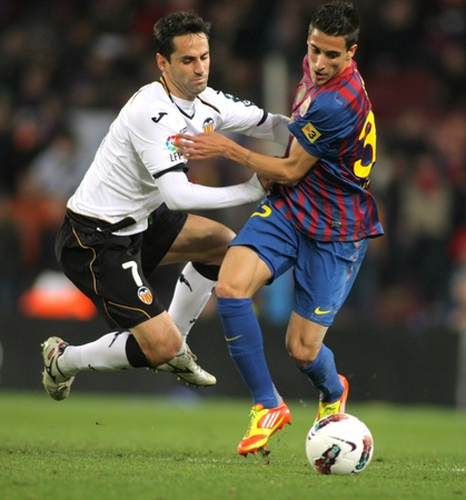 Jonas Gon�alves of Valencia CF vies with Cristian Tello of FC Barcelona during the Spanish league match at the Camp Nou stadium on February 19, 2012 in Barcelona, Spain