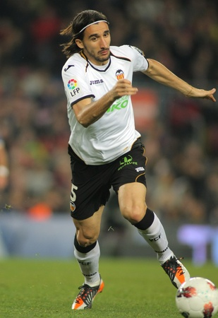 Mehmet Topal of Valencia CF in action during the Spanish league match against FC Barcelona at the Camp Nou stadium on February 19, 2012 in Barcelona, Spain Stock Photo - 13022510