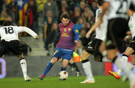 Leo Messi of FC Barcelona in action during the Spanish league match against Valencia CF at the Camp Nou stadium on February 19, 2012 in Barcelona, Spain