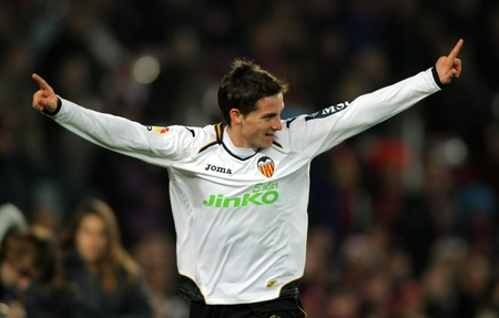 winger: Pablo Piatti of Valencia CF in action during the Spanish league match against FC Barcelona at the Camp Nou stadium on February 19, 2012 in Barcelona, Spain Editorial