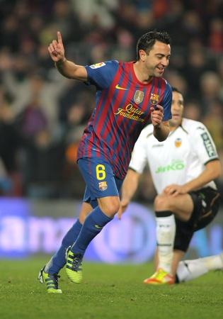 xavi: Xavi Hernandez of FC Barcelona celebrating goal during the Spanish league match against Valencia CF  at the Camp Nou stadium on February 19, 2012 in Barcelona, Spain