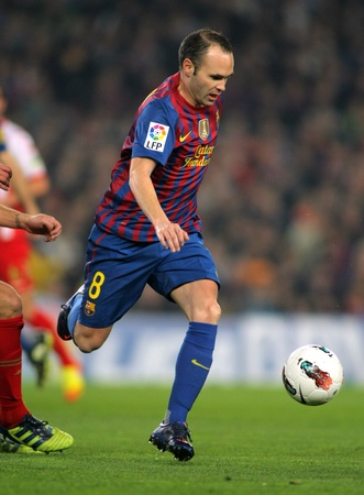 iniesta: Andres Iniesta of FC Barcelona in action  during the Spanish league match against Sporting de Gijon  at the Camp Nou stadium on March 3, 2012 in Barcelona, Spain
