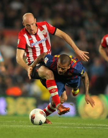 Gaizka Toquero(L) of Athletic Bilbao vies with Dani Alves(R) of Barcelona during the Spanish league match at the Camp Nou stadium on March 31, 2012 in Barcelona, Spain Stock Photo - 13266180