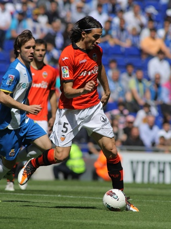 mehmet: Mehmet Topal of Valencia CF in action during a Spanish League match against RCD Espanyol at the Estadi Cornella on April 15, 2012 in Barcelona, Spain