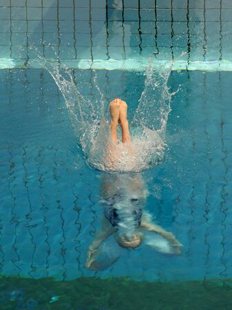 plunge: Swimmer launched into water in a diving competition
