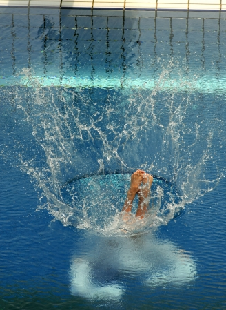 Swimmer launched into water in a diving competition photo