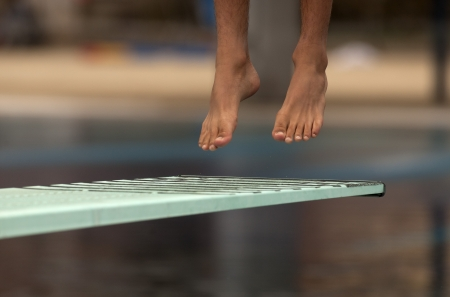 Swimmer launched into water in a diving competition