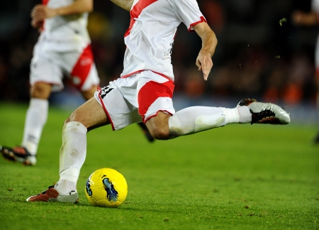 futbol: Soccer player legs in action