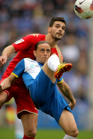 sergio: Sergio Garcia(F) of Espanyol vies with Alberto Botia(B) of Sporting Gijon during a Spanish League match  at the Estadi Cornella on April 28, 2012 in Barcelona, Spain