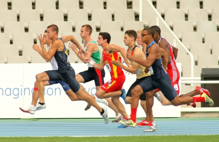 Competitors on start of 100m of Decathlon  men during the 20th World Junior Athletics Championships at the Olympic Stadium on July 10, 2012 in Barcelona, Spain
