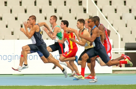 Competitors on start of 100m of Decathlon  men during the 20th World Junior Athletics Championships at the Olympic Stadium on July 10, 2012 in Barcelona, Spain Editorial
