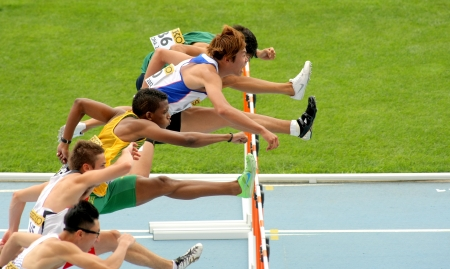 Competitors of 110 meters hurdles during the 20th World Junior Athletics Championships at the Olympic Stadium on July 10, 2012 in Barcelona, Spain