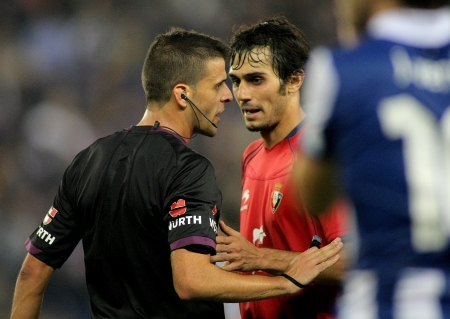 discussed: Alejandro Arribas discussed with the referee Gil Manzano during the a Spanish League match between Espanyol and Osasuna  at the Estadi Cornella on November 10, 2012 in Barcelona, Spain