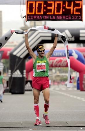 merce: Athlete Roger Roca wins La Cursa de la Merce, a popular race in Montjuich Mountain on September 16, 2012 in Barcelona, Spain Editorial