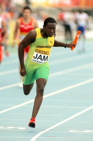 Jazeel Murphy of Jamaica sprinting during the 20th World Junior Athletics Championships at the Olympic Stadium on July 13, 2012 in Barcelona, Spain Stock Photo - 18402479