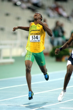 Julian Forte of Jamaica sprinting during the 20th World Junior Athletics Championships at the Olympic Stadium on July 13, 2012 in Barcelona, Spain Stock Photo - 18646051