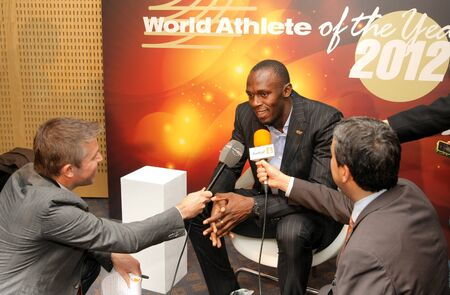 World champion athlete Usain Bolt interviewed by tv channel Eurosport during a Centenary of IAAF at Hotel pullman on November 24, 2012 in Barcelona, Spain Stock Photo - 19184045