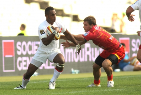 fijian: Timoci Matanavou of Stade Toulousain(L) vies with USAP player during the French rugby union league match at the Olympic Stadium in Barcelona, on September 15, 2012
