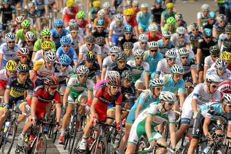 Pack of the cyclists ride during the Tour of Catalonia cycling race through the streets of Monjuich mountain in Barcelona on March 24, 2013
