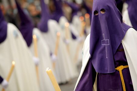 holy week: Man with Hood during a Holy Week parade  Stock Photo
